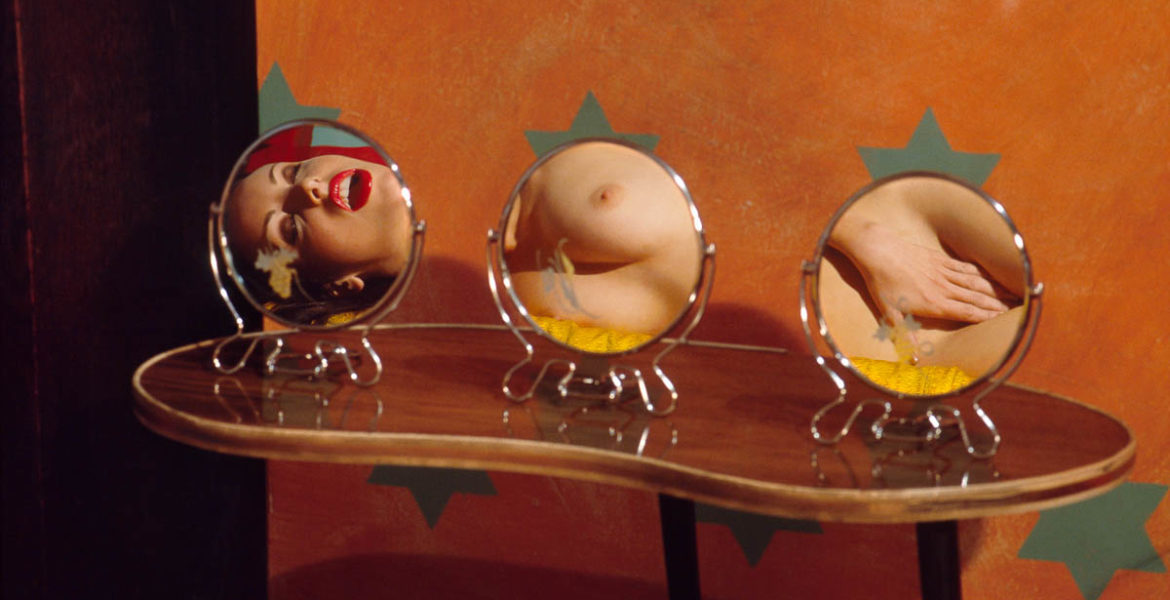 Woman reflected in three mirrors
