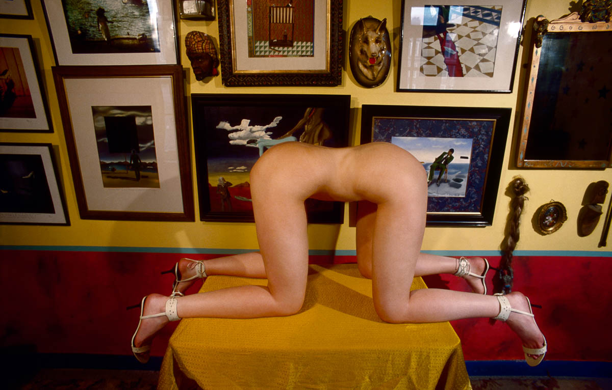 Succubus, distorted nude female torso kneeling on a table