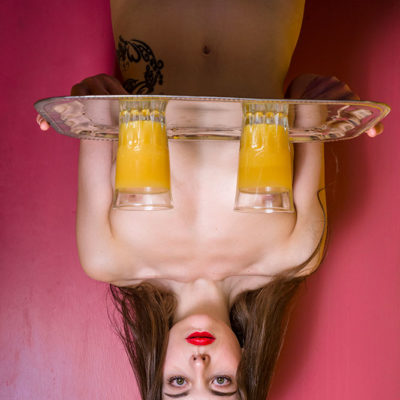 Upside down photo of nude waitress
